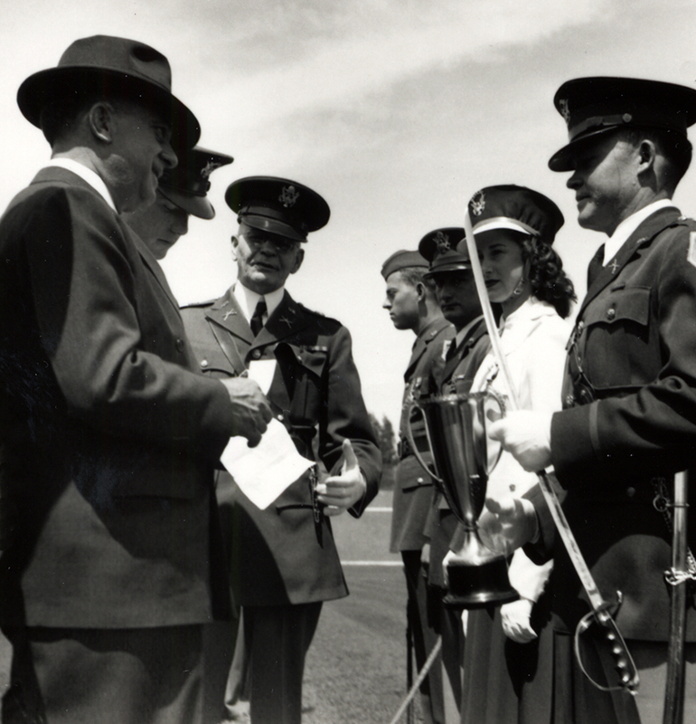 Colonel Clark (center) reviews the ROTC troops