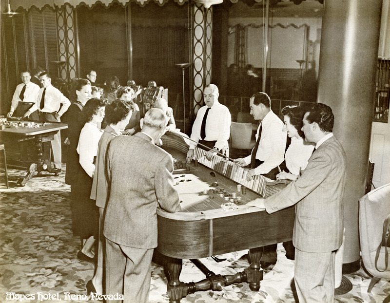 Guests play craps at the Mapes