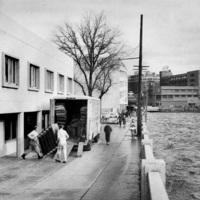 A riverfront view, 1950s
